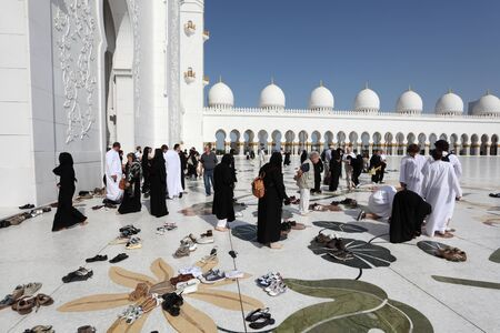 Visitors of the Sheikh Zayed Mosque in Abu Dhabi, United Arab Emirates. Photo taken at 14th of January 2012