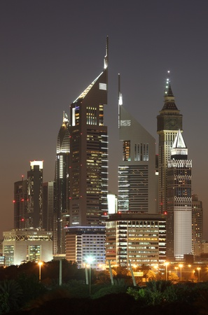 Skyscrapers in Dubai illuminated at night  photo