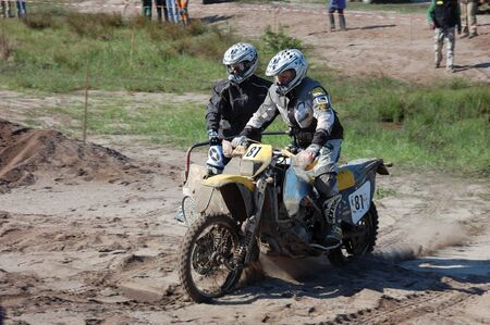fourwheeldrive: Rally motorcycle with sidecar at offroad competition Editorial