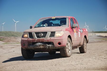 nissan: Nissan SUV at offroad rally competition Editorial