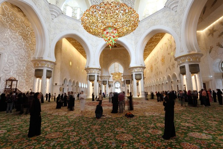 Visitors inside of the Sheikh Zayed Mosque in Abu Dhabi, United Arab Emirates. Photo taken at 14th of January 2012