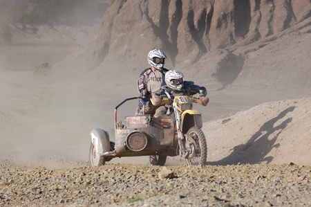 Rally motorcycle with sidecar at offroad competition