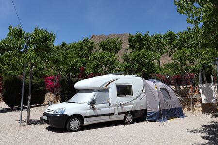 Camper van with tent on a camping site in Spain Stock Photo - 13607877