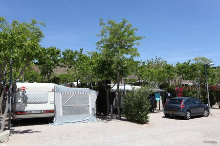 Caravan and car on a camping site in Spain. Photo taken at 7th May 2012