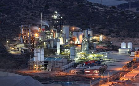 Oil refinery facilities illuminated at night