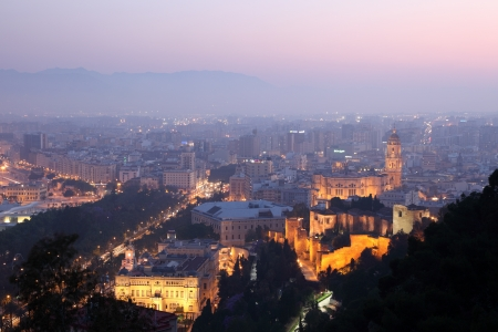 View over the city of Malaga at dusk, Spain