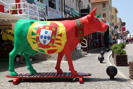 vilamoura: Cow on surfing board painted in national Portuguese colors. Vilamoura Marina, Algarve Portugal