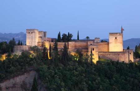 ramparts: Ramparts of the Alhambra illuminated at dusk. Granada, Andalusia Spain