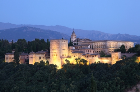Alhambra illuminated at dusk. Granada, Andalusia Spain