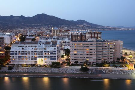 View of town Fuengirola at dusk. Costa del Sol, Andalusia Spain
