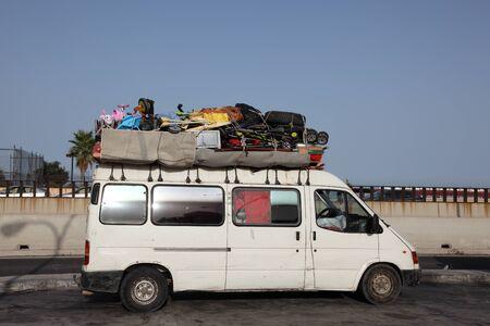 overburden: Overloaded van heading to Morocco