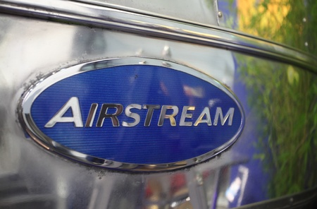 airstream: DUESSELDORF - AUGUST 27: Emblem of an old Airstream caravan at the Caravan Salon Exhibition 2012 on August 27, 2012 in D�sseldorf, Germany.
