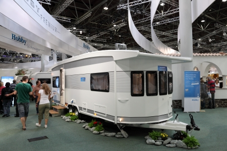 showed: DUSSELDORF - AUGUST 27: Hobby mobile home showed at the Caravan Salon Exhibition 2012 on August 27, 2012 in D�sseldorf, Germany Editorial