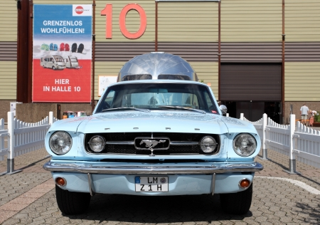 airstream: DUSSELDORF - AUGUST 27: Old Ford Mustang with an Airstream caravan at the Caravan Salon Exhibition 2012 on August 27, 2012 in Dusseldorf, Germany. Editorial