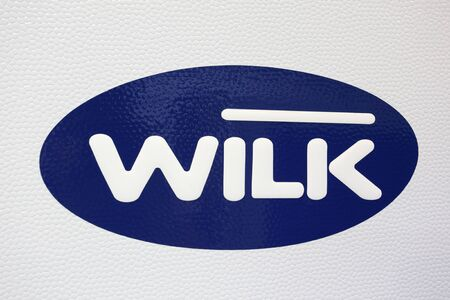 DUSSELDORF - AUGUST 27: Emblem of Wilk -  recreational vehicles manufacturer at the Caravan Salon Exhibition 2012 on August 27, 2012 in Dusseldorf, Germany