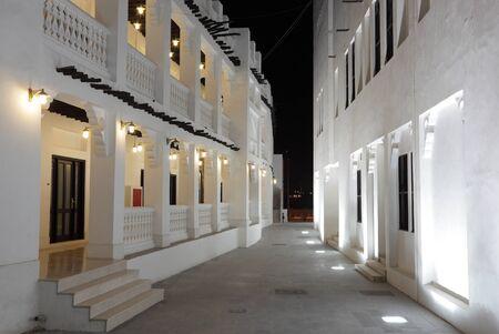 suq: Souq Waqif illuminated at night, Doha Qatar
