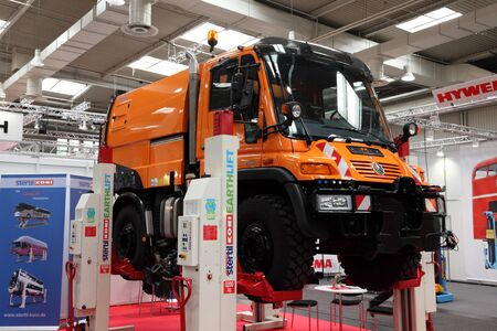 auto hoist: HANNOVER - SEP 20: New Mercedes Benz Unimog Truck at the International Motor Show for Commercial Vehicles on September 20, 2012 in Hannover Germany