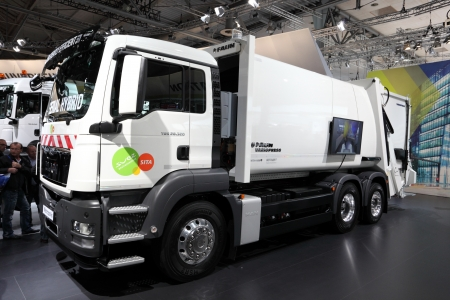 HANNOVER - SEP 20: New MAN Serial Hybrid Variopress Garbage Collection Truck at the International Motor Show for Commercial Vehicles on September 20, 2012 in Hannover Germany