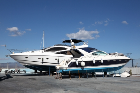 Motor yachts under maintenance in the drydock photo