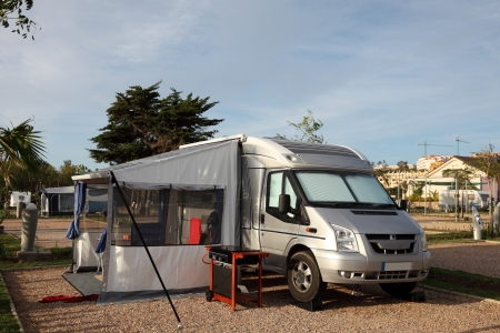 camping site: Motorhome on a camping site in Spain Stock Photo