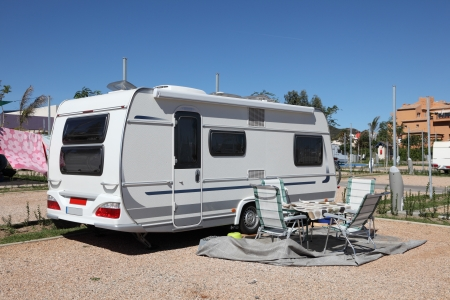 camper trailer: Caravan on a camping site in Spain Stock Photo