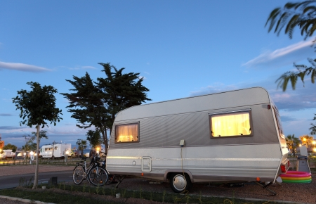 camping site: Caravan on a camping site at dusk