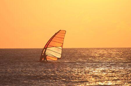 tarifa: Backlit windsurfer at sunset. Tarifa, Andalusia Spain