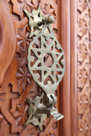 Antique door knocker in Cordoba, Andalusia Spain photo