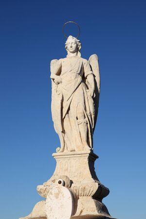 san rafael: San Rafael Archangel statue on Roman bridge in Cordoba, Andalusia Spain