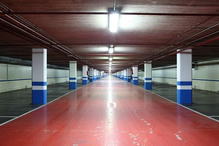 Empty underground garage in a residential building photo