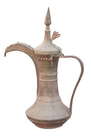 Traditional arabian coffee pot isolated over white background photo