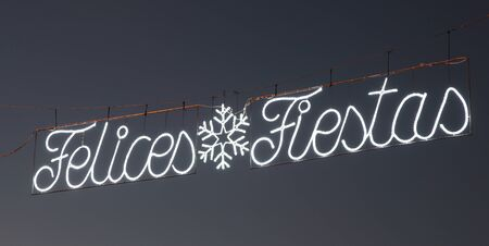 fiestas: Felices Fiestas - Happy Holidays in Spanish. Street decoration in Spain at Christmas time Stock Photo