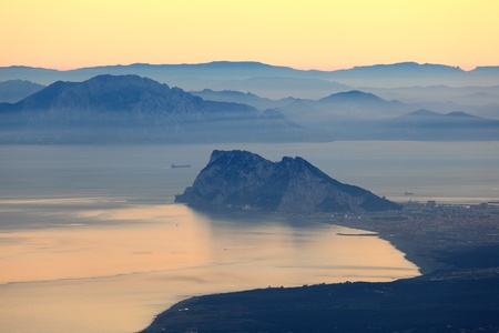 The Rock of Gibraltar and African Coast at sunset photo