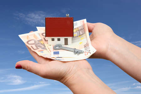 House with money and key with sky background photo