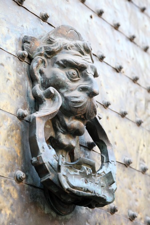 Ancient door knocker in Cordoba, Andalusia Spain photo
