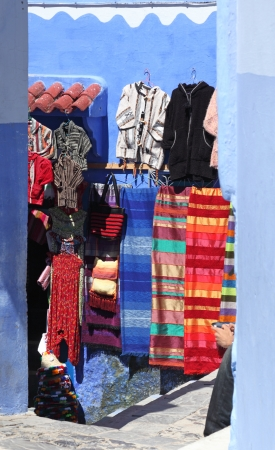artisanry: Traditional moroccan clothes for sale in the medina of Chefchaouen, Morocco