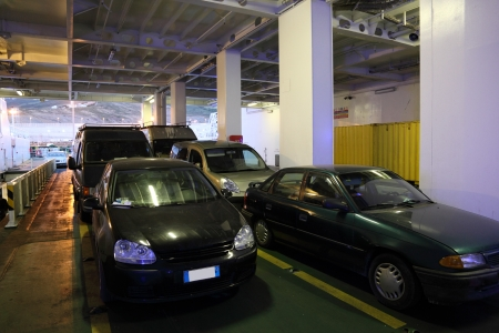 med: Autos in the car deck of a ferry ship in Tangier Med, Morocco