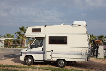 Small european mobile home at a camping site photo