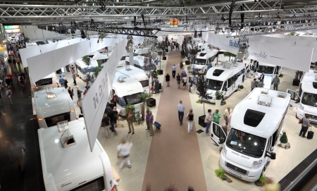 DUSSELDORF - SEPTEMBER 4: Modern Camper vans and caravans presented at the Caravan Salon Exhibition 2013 on September 04, 2013 in Dusseldorf, Germany. Editorial