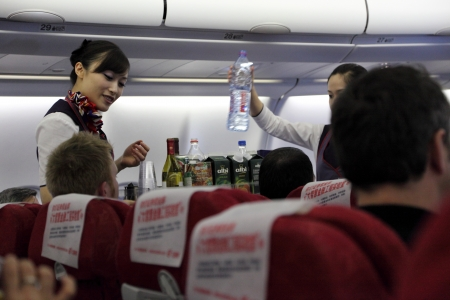 Stewardess serving lunch in China Eastern Airline flight Editorial