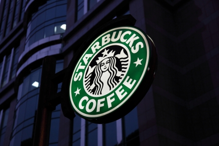 Starbucks Coffee downtown in the city Editorial