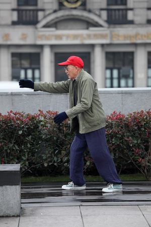 Senior chinese man practicing Tai Chi in Shanghai, China