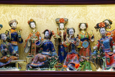 artisanry: Traditional chinese miniature figurines in a souvenir shop. Shanghai, China