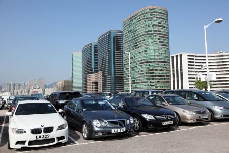 parked: Luxury cars in parking lot in Hong Kong Editorial