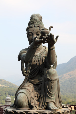 Buddhistic statue making offerings to the Tian Tan Buddha in Hong Kong photo