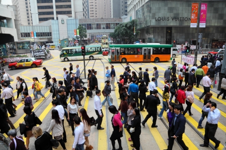 Crowded street crossing downtown in Central Hong Kong, China Editorial