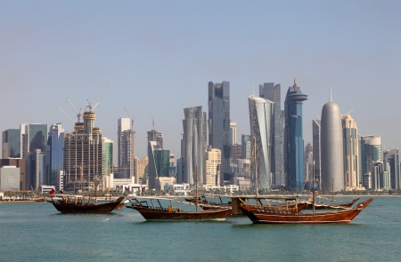 Skyline of Doha with traditional arabic dhows. Qatar, Middle East