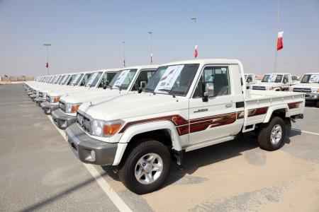 Stock Photo   Toyota Land Cruiser Pickup Trucks As Award For Camel Race  Winners N Doha, Qatar