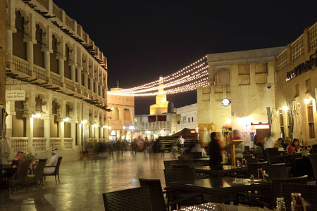souq: Souq Waqif street at night with many cafes and restaurants. Doha, Qatar, Middle East
