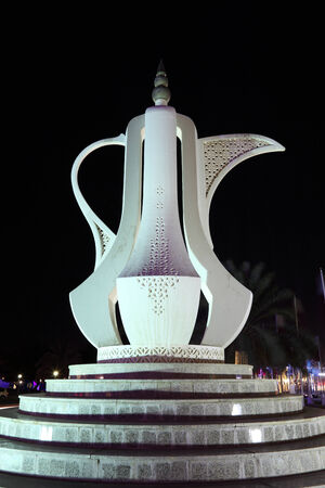 coffee pot: Arabian Coffee Pot in a roundabout in Doha. Qatar, Middle East